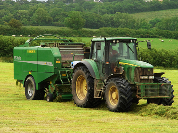 Tractors busy at work harvesting silage for the livestock at Forda Farm B&B. EX22 7BS