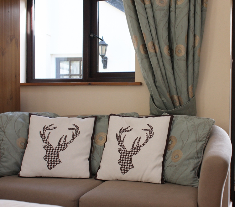 A relaxing sofa in the Tamar room to sit back and relax in after a day explore Devon.
